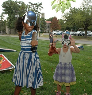 two girls with masks St. Francis Xavier Picnic 2017